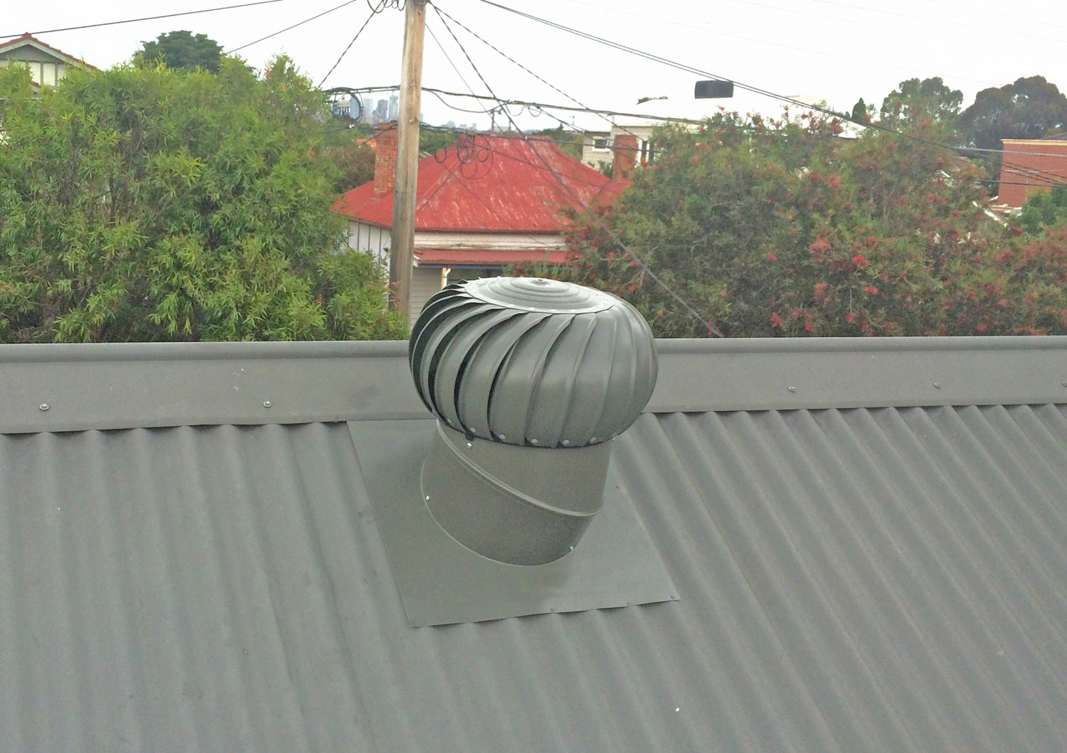 Whirly bird installation on a metal roof, Geelong
